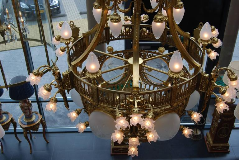 Etched Beautifully cast in gilded 70 lights Chandelier late 19th Century from Amsterdam For Sale