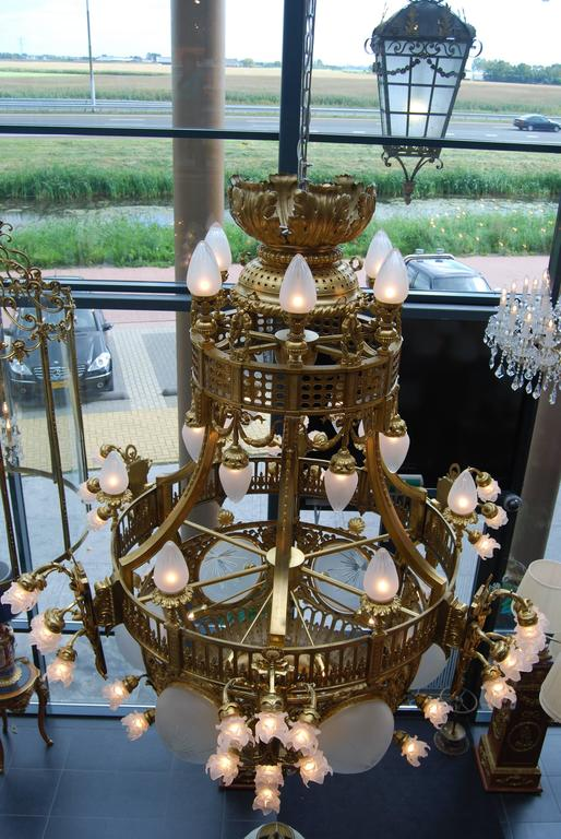 French Beautifully cast in gilded 70 lights Chandelier late 19th Century from Amsterdam For Sale