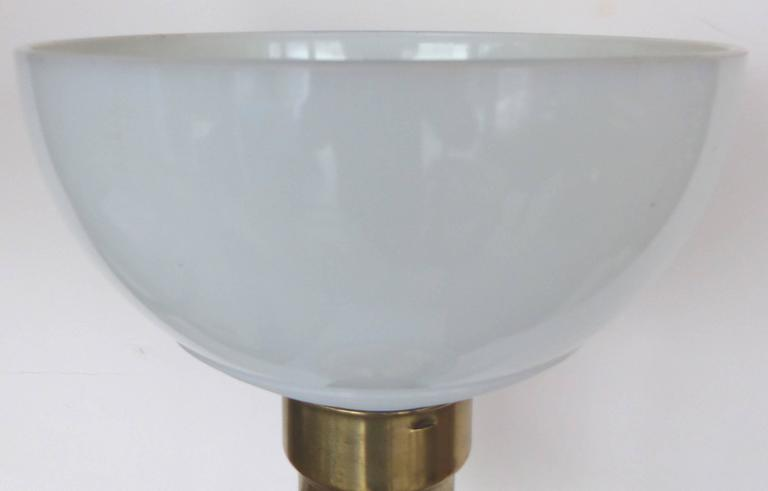 Mid-Century Modern Blue Murano Glass Table Lamp by Marbro  A large Mid-Century Murano glass table lamp by Marbro Lamp Co. supported by an ebonized wood base with brass fittings. The diffuser shade is provided and support a shade above. Retains the