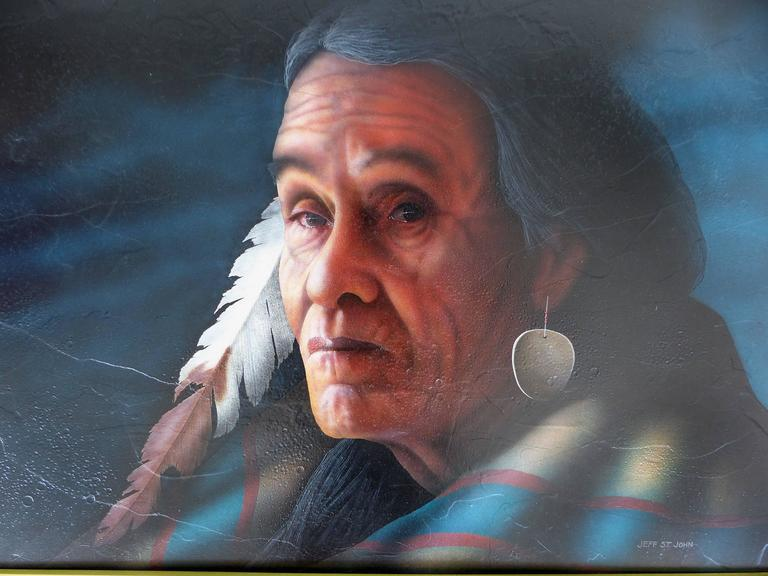 A superb hyper-realism southwestern American Indian portrait by Jeff St.John. A fine example of the southwestern artist's photo-realism techniques. Signed Jeff St. John lower right. Oil on panel, displayed in a mahogany frame with a brass fillet;