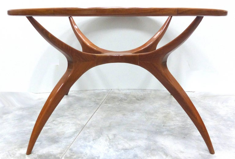 Offered is a sculptural and organic round table designed by Brazilian designer Giuseppe Scapinelli. Dating to the 1960s, the table is made of Peroba de Campos  wood. The table will serve as either a small dining table or a centre table and is fitted