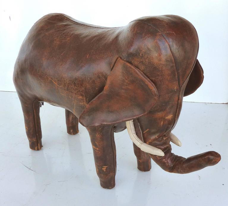 Overscale 1950s Dimitri Omasar of Abercrombie & Fitch Leather Elephant Footstool  Offered is the largest sized leather elephant footstool by Dimitri Omasar created in the 1950s prior to his designing for Abercrombie and Fitch. The elephant is marked