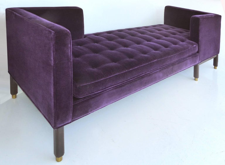 Offered for sale is a rare Dunbar tête-à-tête sofa (model 5944) designed by Edward Wormley, circa 1950. Beautifully upholstered in a rich royal purple velvet on a walnut frame with brass details.