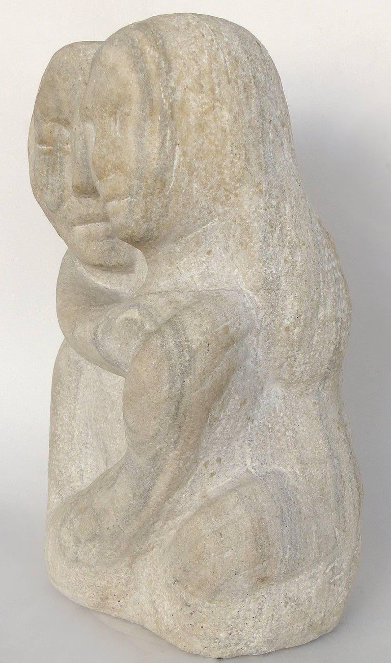Midcentury figurative carved limestone sculpture by