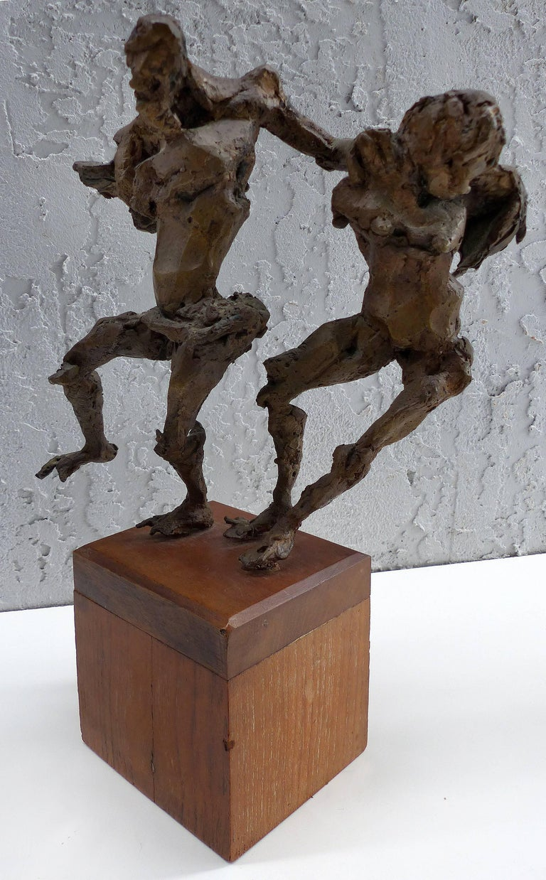 Linda Goodman Bronze Figurative Sculpture  Offered for sale is a Brutalist bronze sculpture by the American artist Linda Goodman  (1910-2004). This Mid-Century Modern bronze sculpture depicts two frolicking figures supported upon a wooden base.