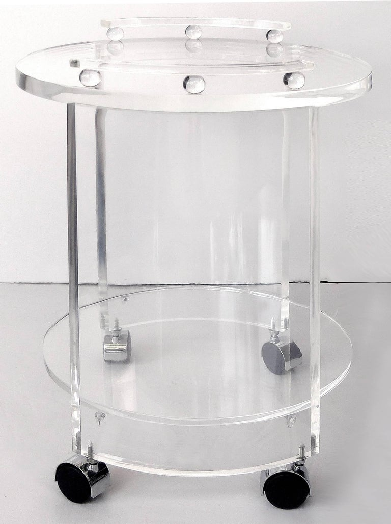 Round Lucite Bar Cart on Casters  Offered for sale is a two-tiered round Lucite bar cart. Custom made by Iconic Design, these carts can be customized.