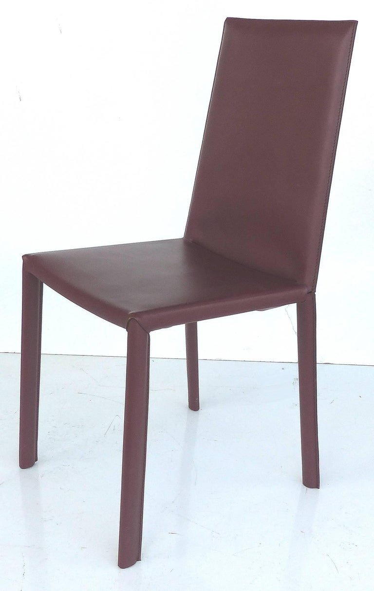Arrben of Italy Leather Clad High Back Salinas Two Dining Chairs, Set of Six  Offered for sale is a set of six dining chairs manufactured by Arrben of Italy, a family owned company since 1969 that focuses on producing high end contemporary design