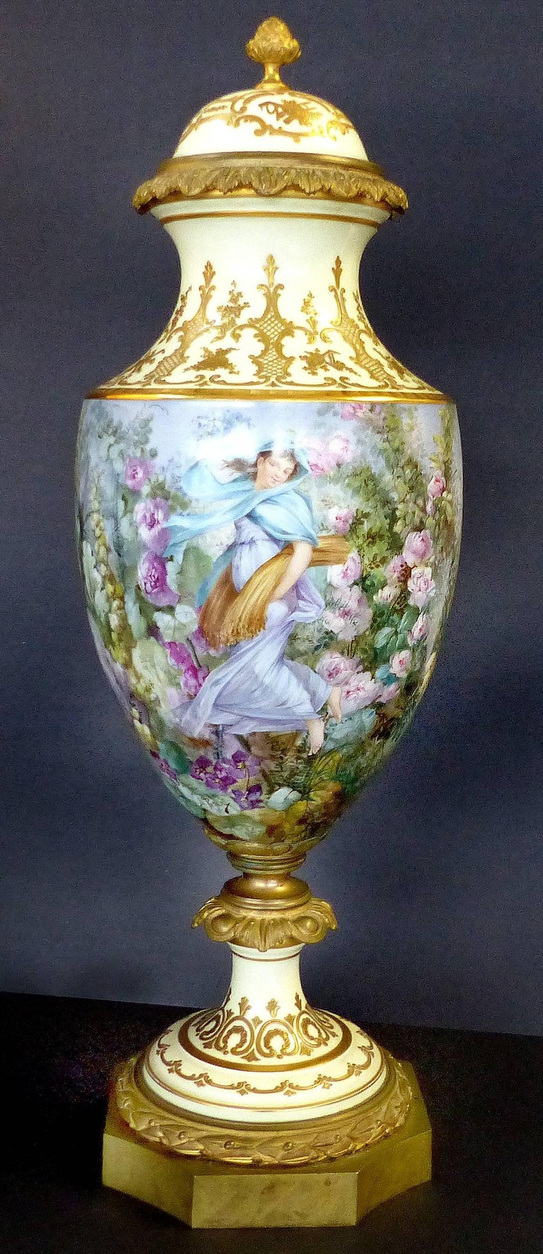 Offered is a fine Sevres hand-painted covered urn signed L. Pater. This gilt bronze mounted covered porcelain urn in three parts, beautifully painted with a harvest scene and elaborate floral designs. Artist signed within the design and marked