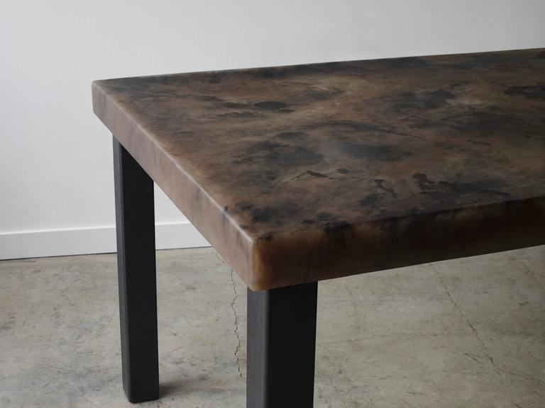 Iconic Parsons style table with resin lipped tabletop and steel legs. The resin tabletop can be poured in over 40 different colors or combination of making the options endless. Martha Sturdy resin is stain resistant, food safe, warm to the touch and
