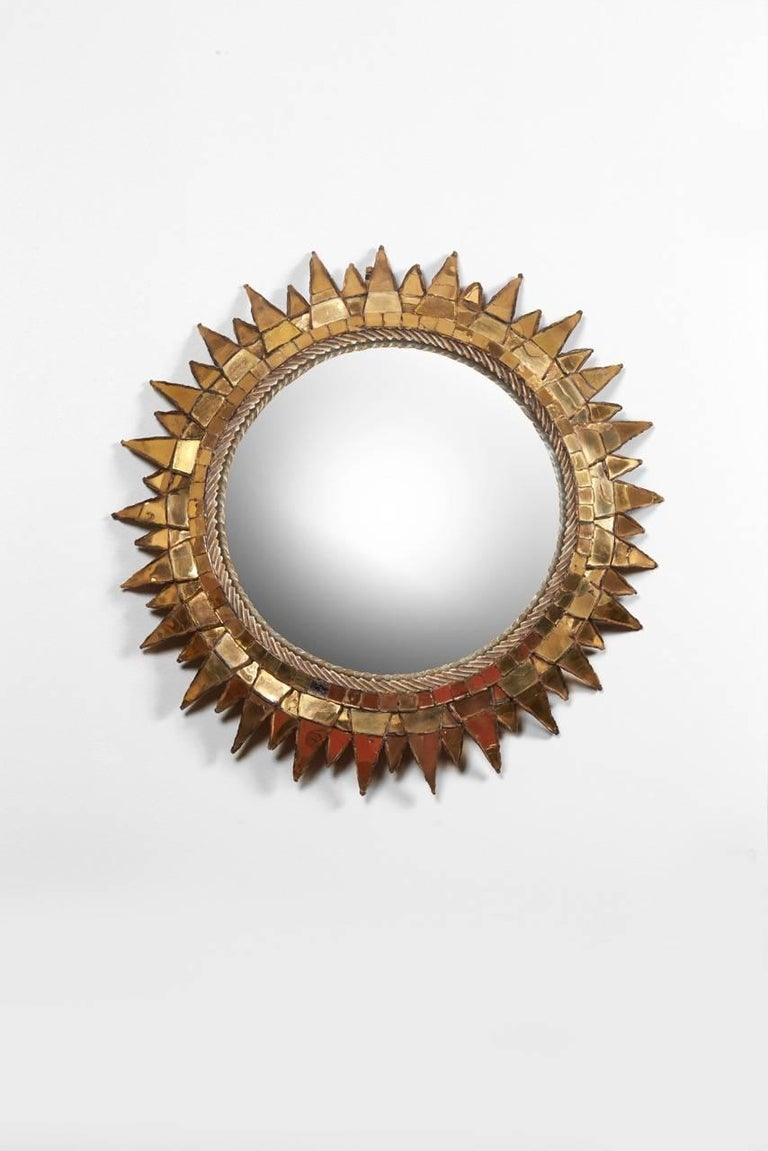 A Circular convex mirror in talosel and gold mirror. Signed