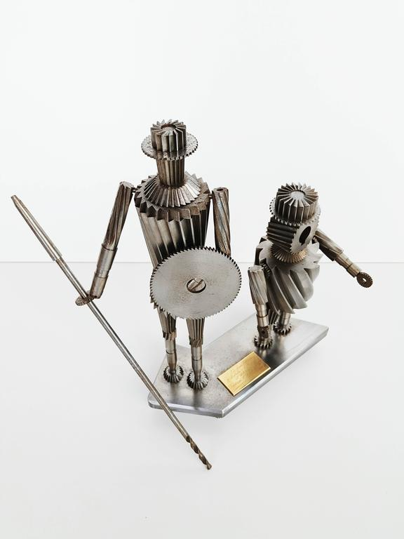 Incredible metal sculpture representing Don Quixote and Sancho Penza,  dated 1967 Spain.  The arms are articulated, it is a very precise work made of different gears, the whole being very heavy. Don Quixote, a Spanish novel by Miguel de Cervantes