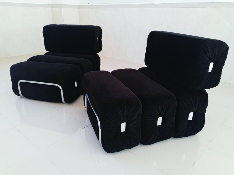 Rare and beautiful pair of French lounge armchairs manufactured in 1970s, in perfect vintage condition with black velvet original fabric and chrome tubular structure. Foam and fabric in perfect condition.