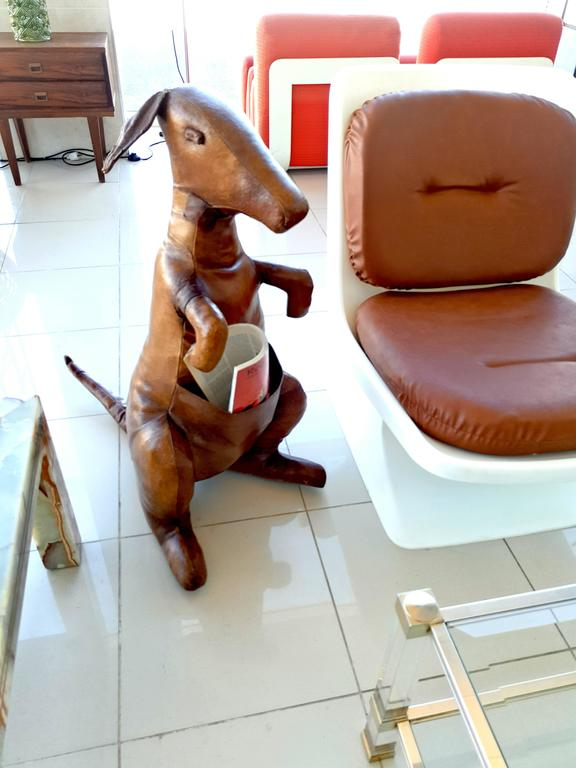 Here for a very nice and extremely decorative leather magazine holder Kangaroo designed by Dimitri Omersa, England, 1960. The Kangaroo is one of the rarer and nicest animals produced by Dimitri Omersa for Liberty's. This kangaroo was made of top