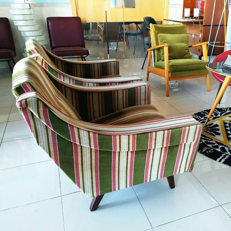 Beautiful pair of 1950s, Italian armchairs in the style of Gio Ponti, with an original striped velvet fabric, in perfect vintage condition.