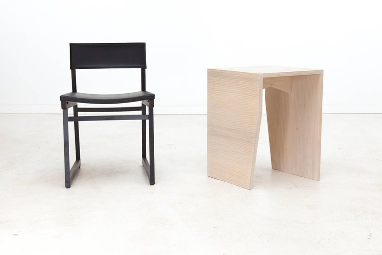 The angles and form of the Zooey side table are a nod to Brutalist architecture and Minimalist sculpture of the 1960s and 1970s. Shown in cerused ash and available in a variety of American hardwoods. The Zooey side table is made to order, so