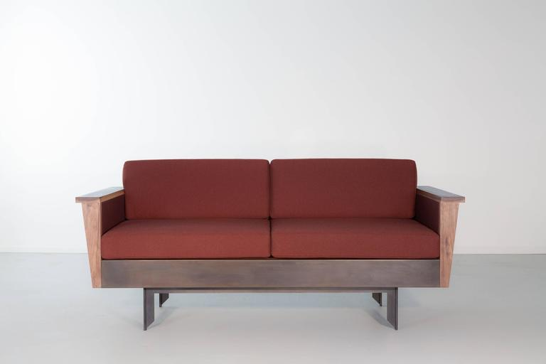 The combination of industrial press-formed steel and American hardwood make the Louise Sofa an investigation of material contrasts.  Available in Maharam 100% wool felt or tweed as well as COM or COL.  The Louise Sofa is made to order so dimensions,
