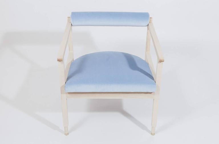 As shown: Solid white oak with cerused finish and coral linen upholstery. Solid bleached ash with light blue cotton upholstery fabric by Maharam or grey wool upholstery fabric by Kvadrat for Maharam. Oil and wax or flat waterborne