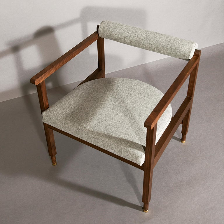As shown:  Solid walnut with grey wool upholstery. Oil and wax finish. Dimensions: 26 1/2