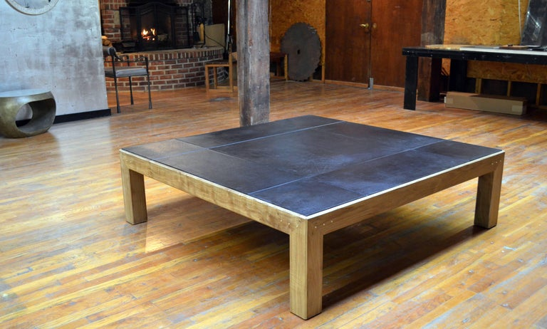 Walnut construction with hand-dyed saddle leather top available in five colors: Dark brown, natural, black (shown), jade and aubergine. Brass details on all sides. Size is customizable; oak or ebonized ash construction also an option.