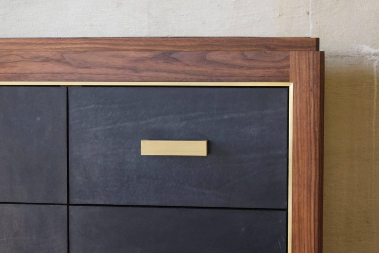 Inspired by Mid-Century Modern Mexican design, this 12-drawer bureau is made with solid walnut construction with hand-dyed saddle leather drawer faces and blotter. Saddle leather choices include natural, dark brown, black, jade or Aubergine