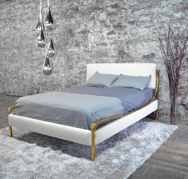 Hand carved and cast silicone bronze frame with fabric or leather upholstered headboard and rails (COM/COL). Each bed is customized to the specified mattress height.