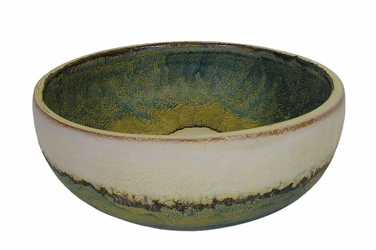 A ceramic pottery bowl from the 1970s by Marcello Fantoni of Italy. Decorated throughout using in multi-toned matte and semi-matte glaze and featuring a beautifully patterned interior. Bowl is signed on the bottom and in excellent condition.