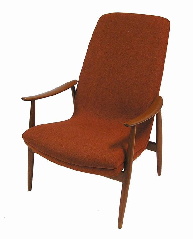 A stylish teak lounge chair designed by Ingmar Relling for Westnofa of Norway. Gorgeous Scandinavian Modern era lines with beautifully crafted armrests and removable head cushion. Newly re-foamed but retaining the original rust colored fabric and in