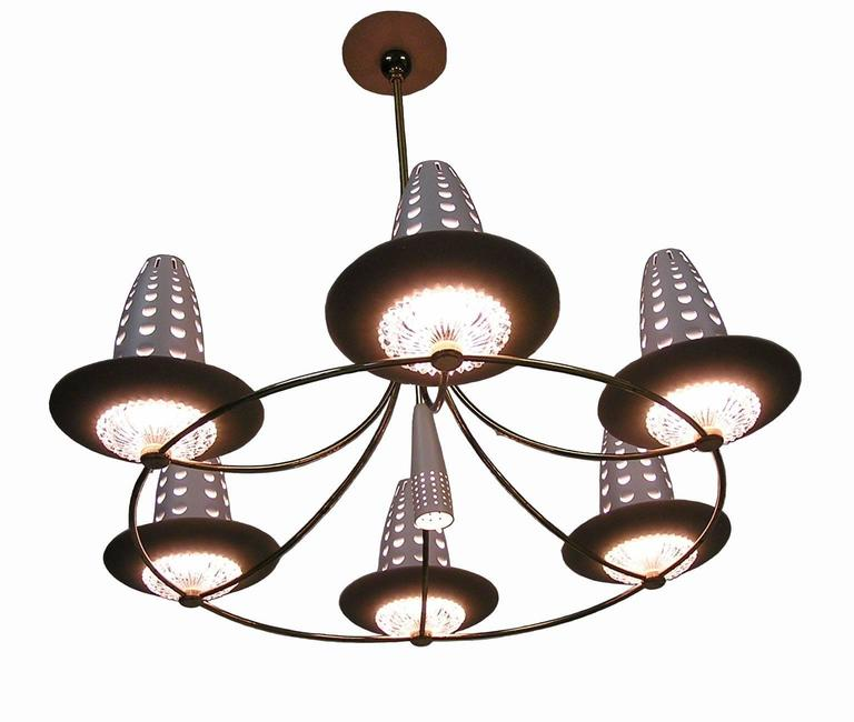 A stunning six-branch brass and glass chandelier by one of the notable lighting designer's of the Mid-Century Modern era. Designed by Gerald Thurston for Lightolier in the 1950s and featuring six branched sockets with beautifully crafted lower