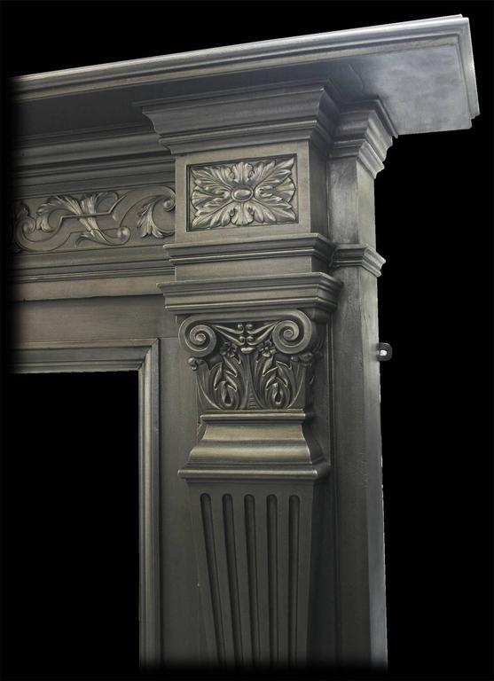 Large and imposing antique Victorian cast iron fire surround by the Coalbrookdale Foundry. With tapering fluted pilasters terminating in acanthus and scroll capitals below corner capitals with cast paterae, either side of further acanthus leaves and