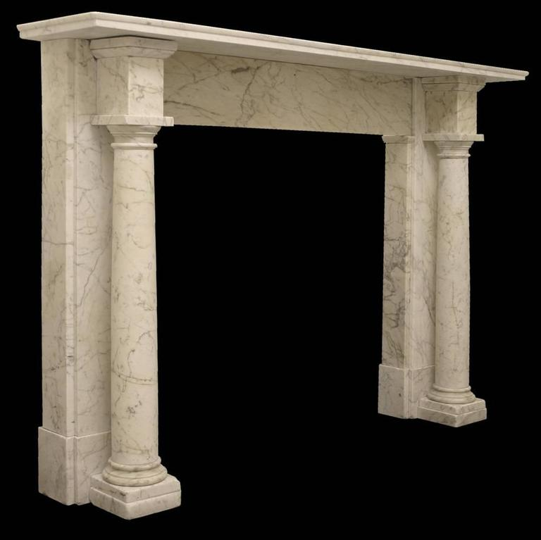 Beautifully uncomplicated early Victorian Carrara marble fire surround with freestanding Tuscan columns, terminating in block capitals.