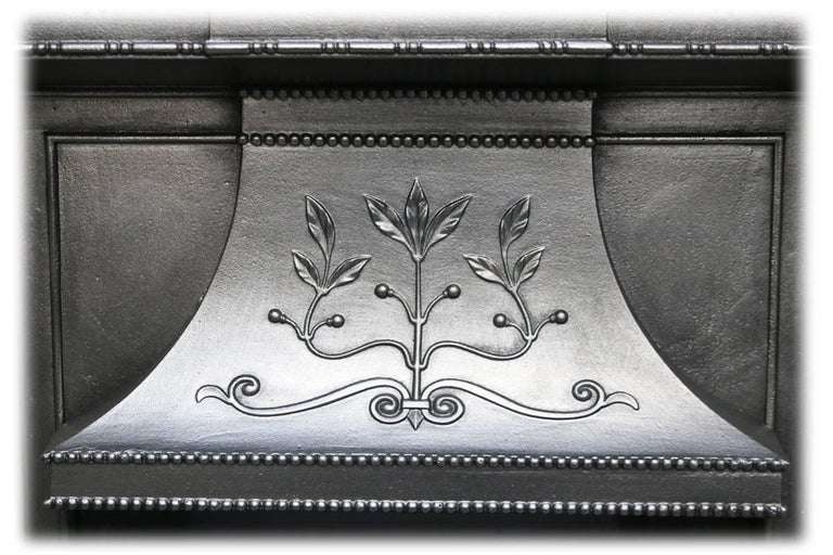 Large antique Edwardian Art Nouveau cast iron combination fireplace. Cast with fine flowing tendrils, styalised flowers and leaves, typical of the Art Nouveau style, circa 1905. 