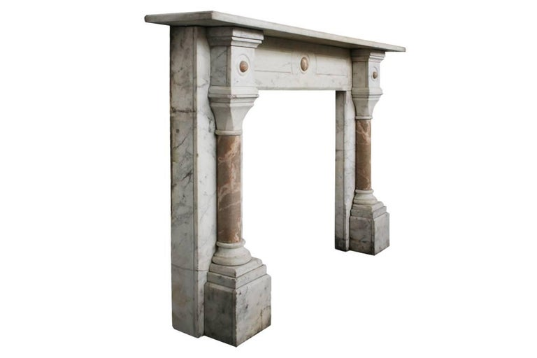 Large antique late Victorian Carrara marble fireplace surround, with crema valencia marble pillars and decoration to the capitals. Images prior to restoration, circa 1860. This fireplace is awaiting restoration, please enquire about the lead time
