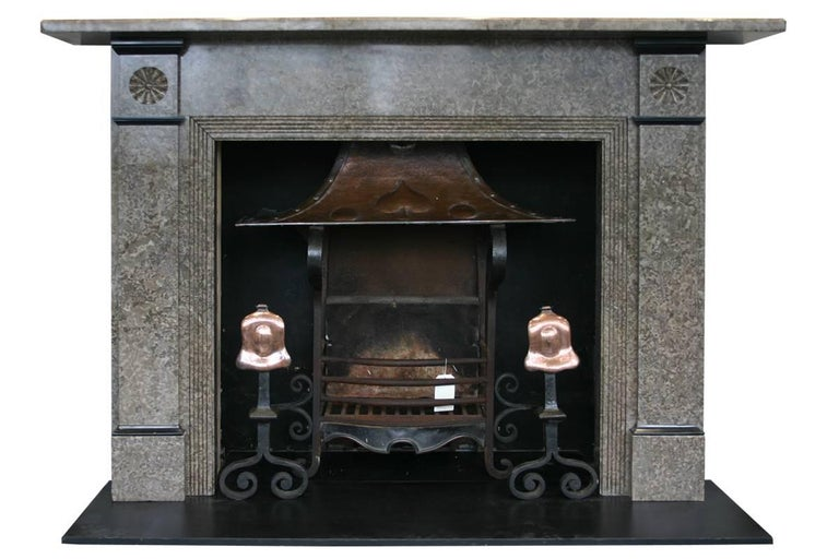 Large but elegant antique Edwardian Derbyshire limestone fireplace surround with rosette carved capitals, reeded returns and black marble interruptions.