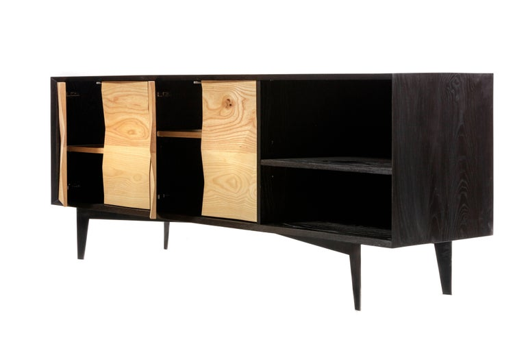 Our Westchester credenza was derived from the variations of ice crystals on Westchester Lagoon in southeast Alaska. The ebonized ash credenza incorporates custom fabricated ash doors to mimic the variations and complexities of natural surfaces. The