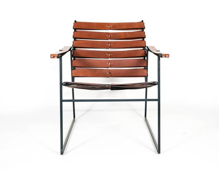 Chosen as one of 'Design Milk's' favorite finds at the Architectural Digest Home Show 2016 in NYC. Hand-sewn leather and powder coated steel combine to create this lounger worthy of enjoying your favorite bourbon.  Matching ottoman sold