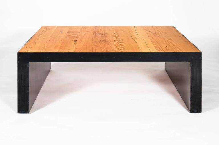 Stunning reclaimed fir table from the forests of Montana, supported by a modern steel base. Options for wood and steel finishes are available upon request.  This item can also be made to a custom size upon request.
