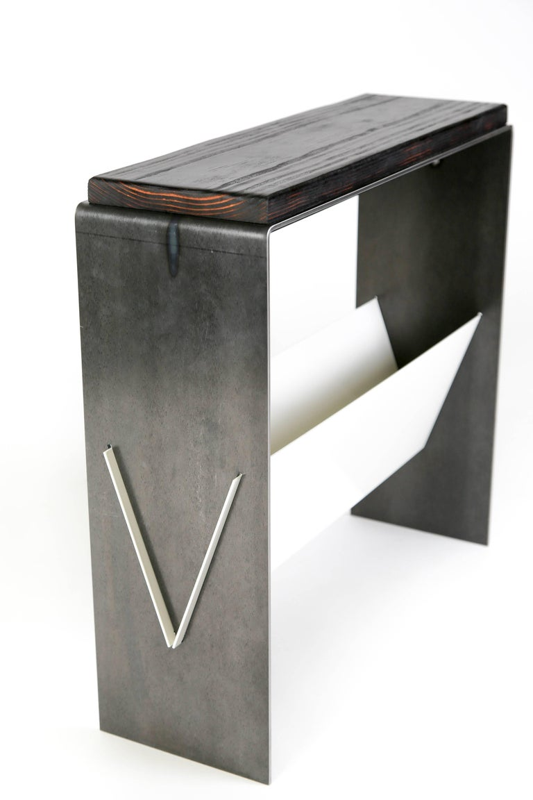This simple side table or end table brings a modern aesthetic of simplicity and cleanliness. A versatile table that can be used as a side table, end table, or cocktail table allows for magazine or book storage below in a sleek niche. Available in
