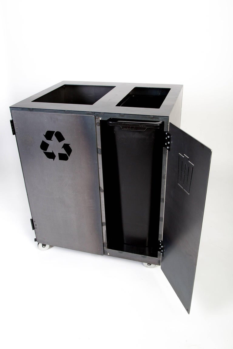 This modern, handmade steel storage cabinet is a versatile solution to your trash and recycling needs. Perfect for hotels, restaurants, shopping complexes and businesses ; this piece is handmade in Bozeman, Montana to become to the perfect piece of