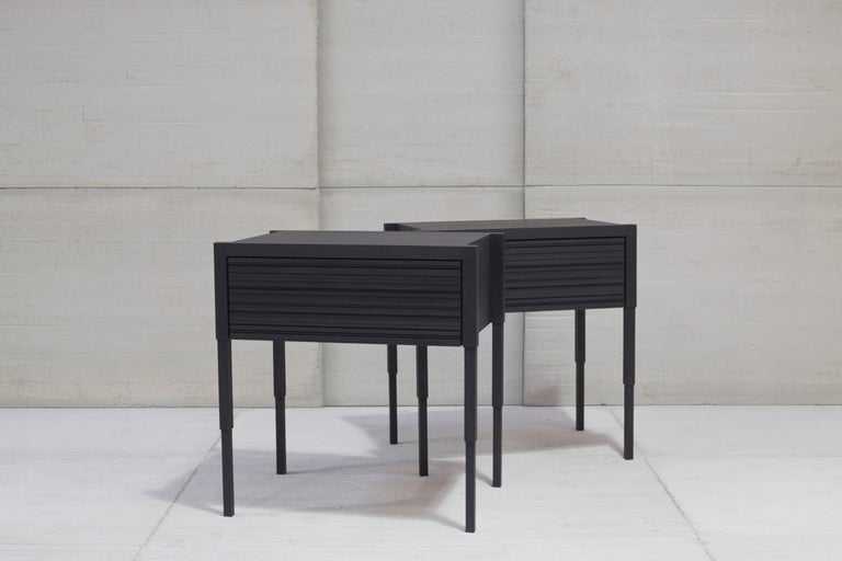 This architecturally inspired side table or nightstand's refined lines and consideration to details are the acme to its design. Each unit is fabricated by hand and is available in a combination of drawer fronts and case finishes.    Item: Chicago