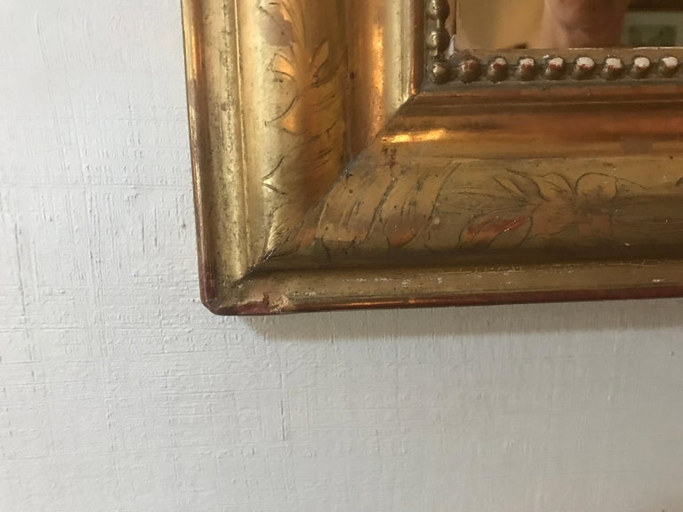 19th century giltwood Louis Phillipe mirror with Regency accent on top.  Mirror is  29
