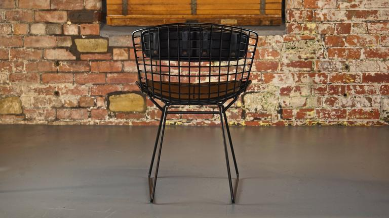 Set of four Harry Bertoia wire chairs/side chairs for Knoll black.  Design year: 1952. Designer: Harry Bertoia. Manufacturer: Knoll. Materials: Welded steel rod, black Rilsan coating.  An icon of Mid-Century design.  This listing is for a set of 8