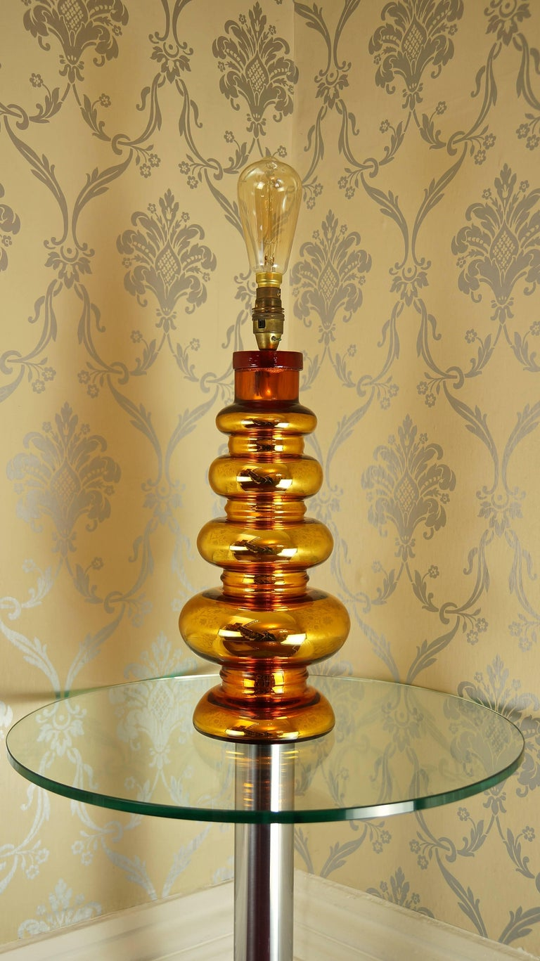 A beautifully crafted gold coloured mercury glass table lamp, with signature textured glass cap by Johansfors Glasbruk of Sweden dating from the 1960s.  The glamorous gold colour and incredible form of this lamp make it a very eye-catching piece