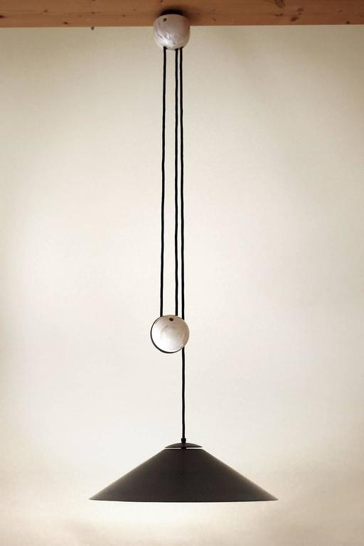 Large brass and marble adjustable counterweight pendant.  Germany, 1960s. Solid brass schade with beautiful patina. The outside is burnished and the inside is brushed. Measurements: Diameter: 19.5 in, Height (lampshade): 6.2 in; Lamp sockets: 2x E27