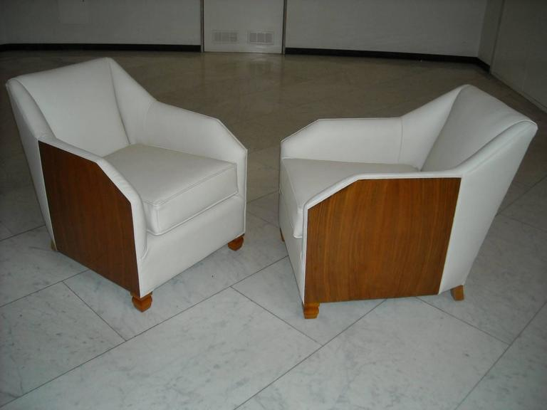 Charming small pair of 1930 armchairs completely restored re upholstered and covered with off white leather.