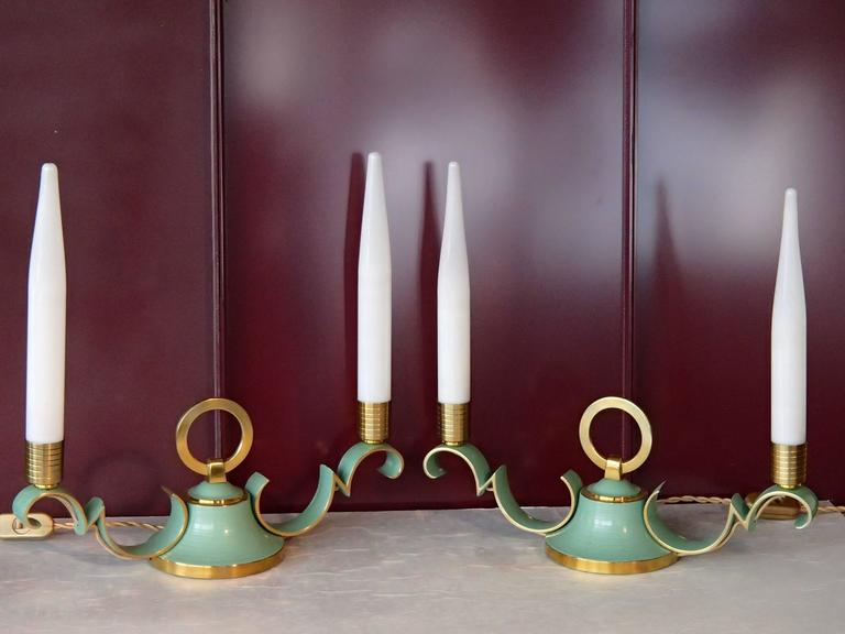 Pair of 1940 brass table bedside or sideboard lamps with green emanel and opal tubes. The tubes are slightly different high and minor loses of paint.