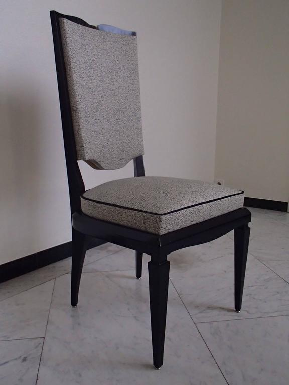 six black 1940 dinning room chairs covered with black and