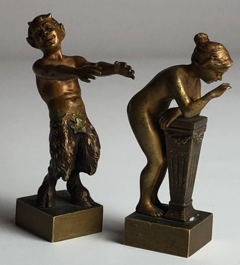 An amusing pair of erotic Vienna bronzes, the nymph and the satyr by Bergman.  Both marked B in the base.  Cold painted bronze. Austria  The pair stand 3