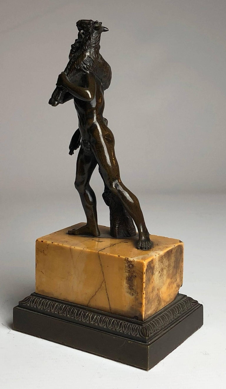 Superb quality bronze depicting the ancient Greek cult, kriophoros.  On a sienna marble and bronze base.  Measure: He stands 8