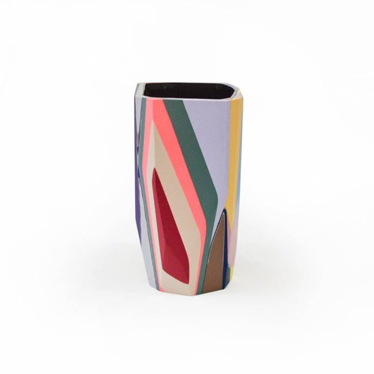 The vibrant Amorgos Vase, named for the colorful Greek coastal town, is part of our Black Magic collection of resin vessels, inspired by the concept of revealing that which has been hidden from sight, but remains ever-present.  Gazing toward the