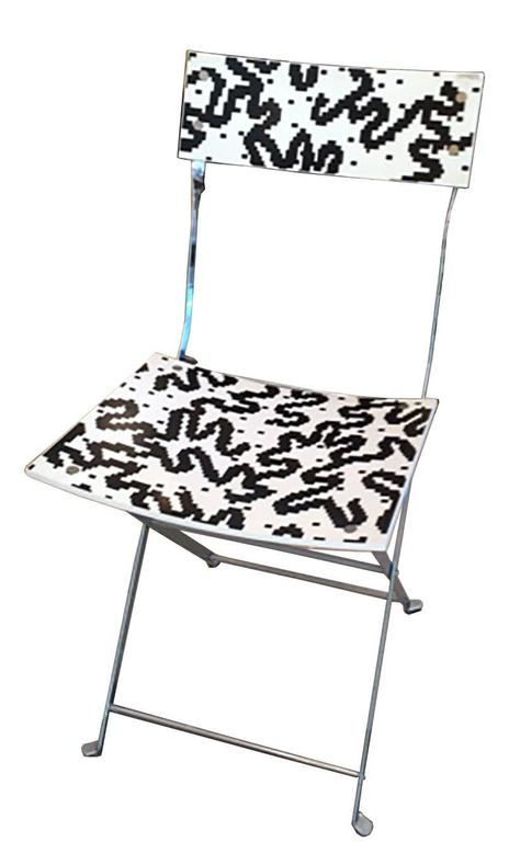 Four folding chairs by Alessandro Mendini in steel and plastic decorated by Bruno Gregor. Producted by Nuova Anchimia, Zabro Collection, Italy, 1985.